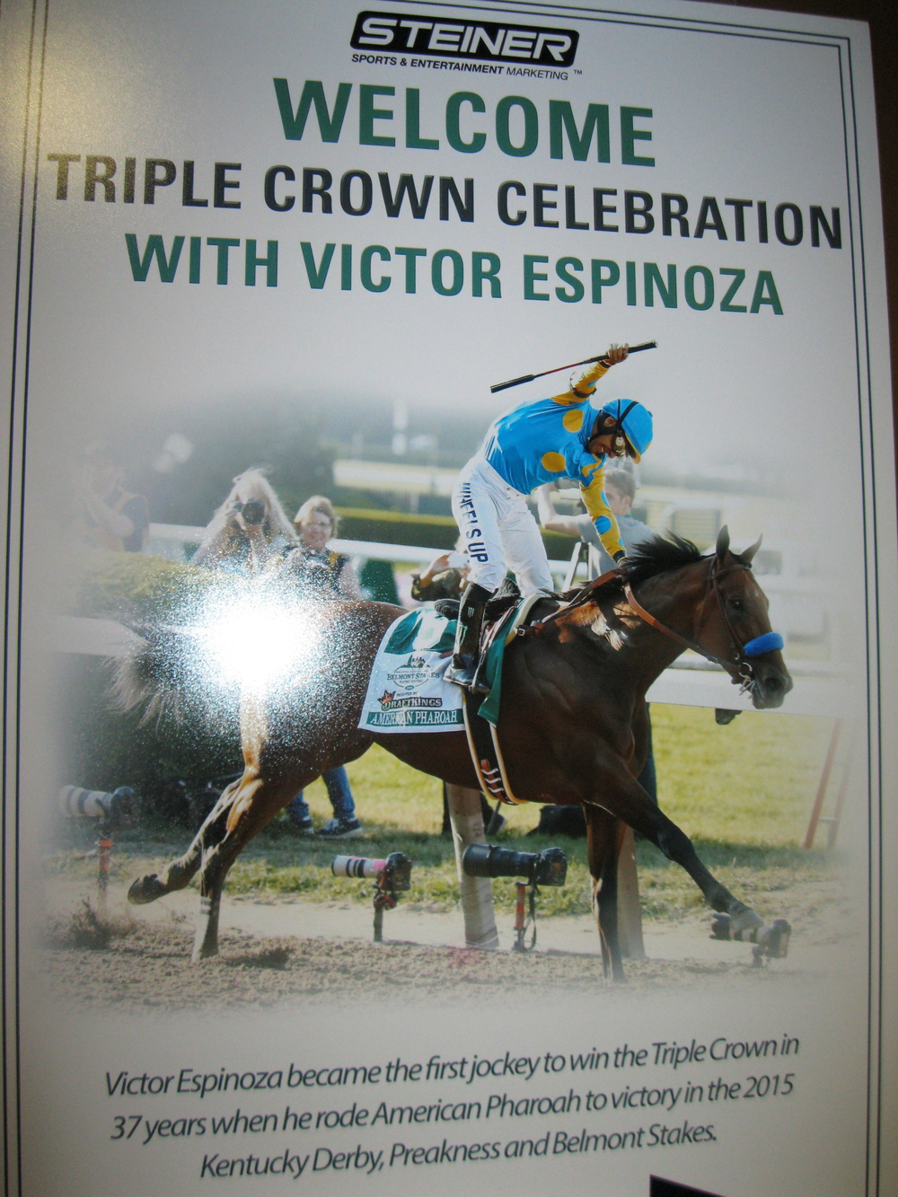 "Poster for the ""Victor Espinoza Triple Crown Celebration."" Photograph by Georgette Gouveia."