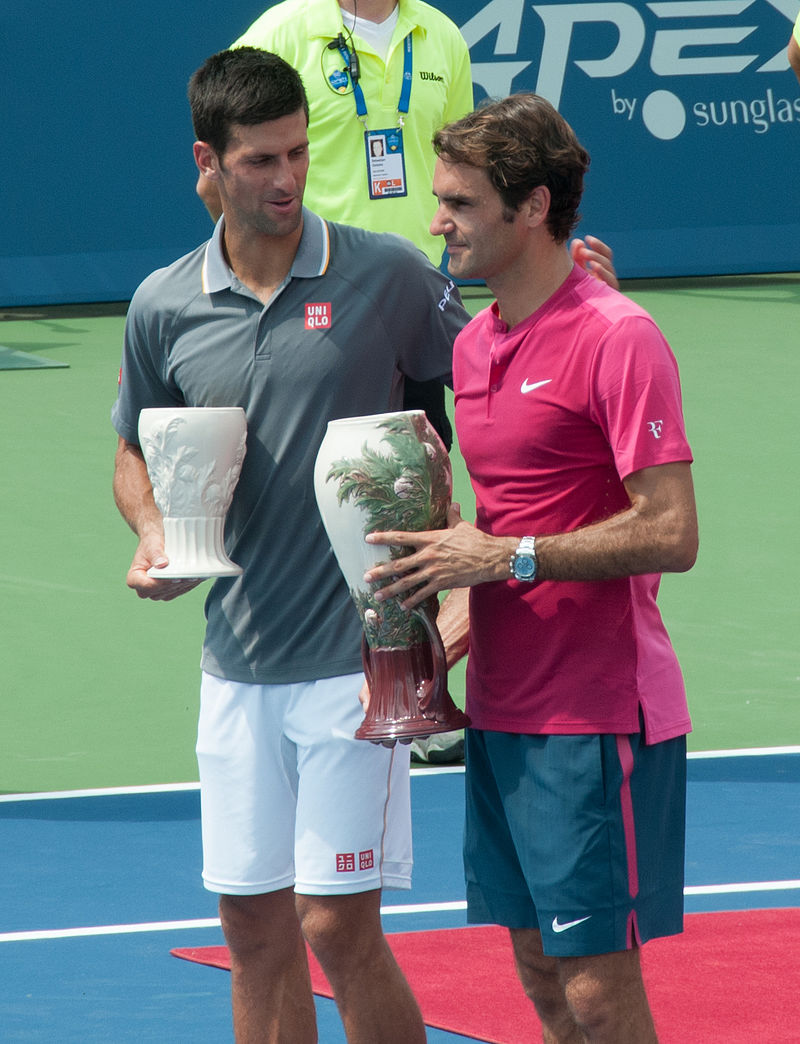 Novak Djokovic congratulates Roger Federer on his win at the Western & Southern Open in Cincinnati over the summer. The two won't be meeting at the Shanghai Rolex Masters as Fed lost to qualifier Albert Ramos-Vinolas Tuesday.