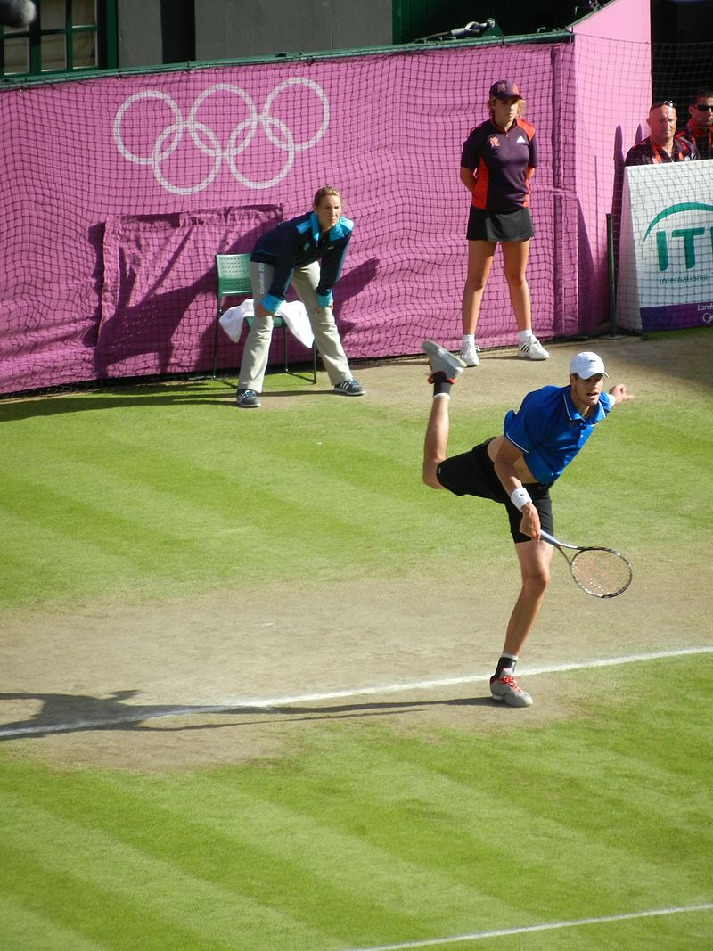 John Isner, seen here serving to Roger Federer in the quarterfinals of the 2012 Olympics, beat Fed in Paris only to lose to David Ferrer.