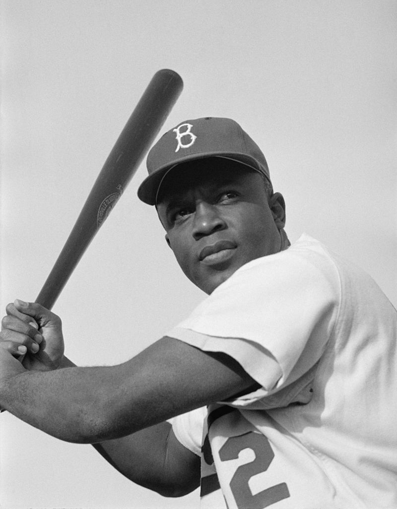 High noon of a god: Brooklyn Dodger second baseman Jackie Robinson in 1954. Photograph by Look magazine's Bob Sandberg. Restoration by Adam Cuerden. Photograph available from the Library of Congress' Prints and Photographs division.