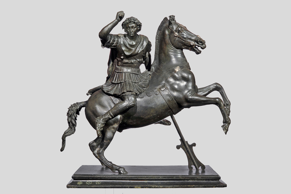 """Small Statue of Alexander the Great Astride Bucephalos,"" Roman, late Republican or early Imperial period, second half of the 1st century B.C.; copy of a Greek original from circa 320-300 B.C., bronze, Museo Archeologico Nazionale, Naples. Courtesy The Metropolitan Museum of Art."