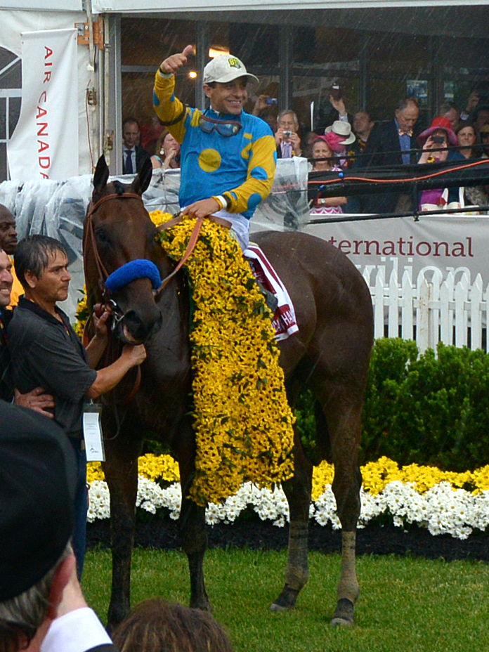 American Pharoah, with Victor Espinoza aboard, after his Preakness win.