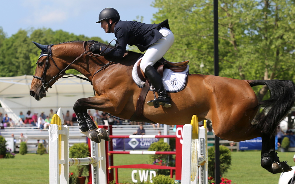 McLain Ward and HH Azur: McLain Ward and his Olympic hopeful HH Azur make a perfect pair at the Old Salem Farm Spring Horse Shows. Photograph by Lindsay Brock for Jump Media.