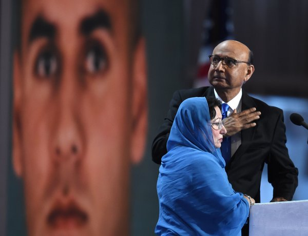 Khizr Khan, father of Humayun Khan, who was killed while serving in Iraq with the U.S. Army, gestures as his wife, Ghazala, looks on during the final evening of the Democratic National Convention. Timothy A. Clary/AFP/Getty Images. As seen at NPR.org.