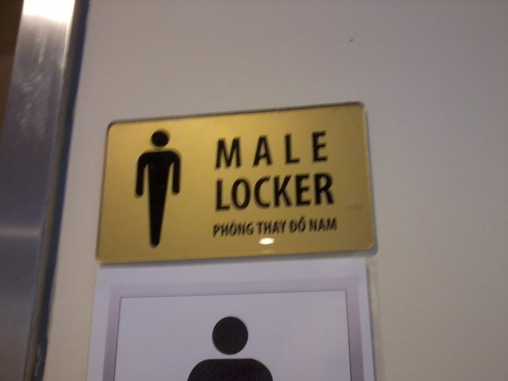 Sign for a swimming pool locker room in Hanoi, Vietnam.