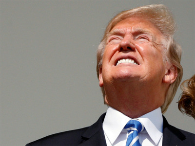 Trump looks at the sun during the Aug. 21, 2017 eclipse. Image  here .
