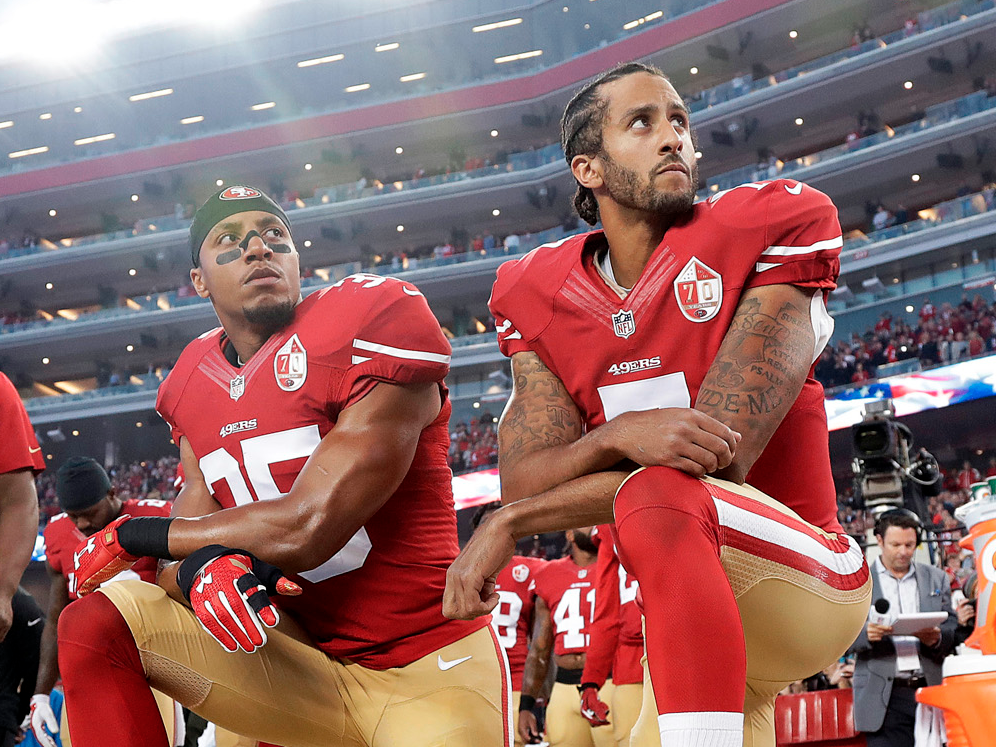 Colin Kaepernick takes a knee with Eric Reid. Image  here .