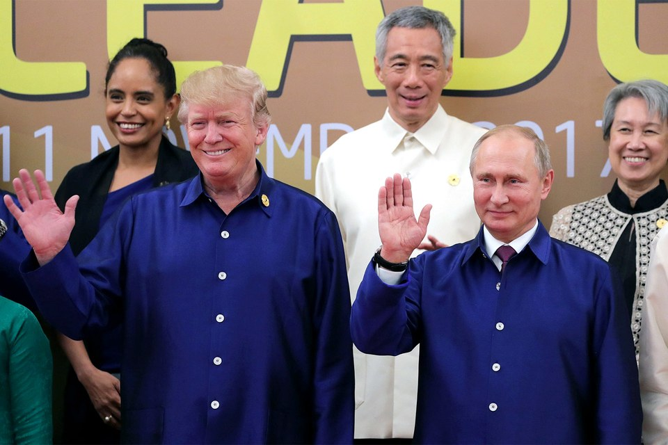 All smiles Nov. 10 at the recent APEC Summit in Vietnam but trouble looms for Trump at home. By Mikhail Klimentyev/AFP/Getty Images.