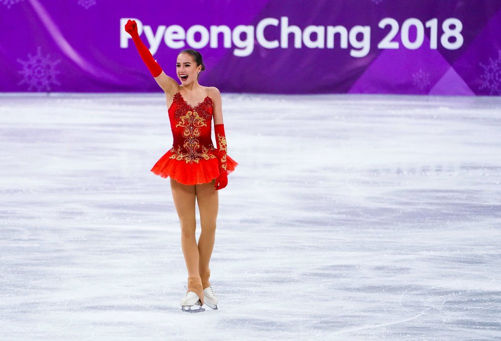 Zagitova celebrating after her gold medal-winning performance.CreditDoug Mills/The New York Times. Image  here .