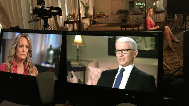 """Daniels and Cooper on """"60 Minutes."""" Image  here ."""