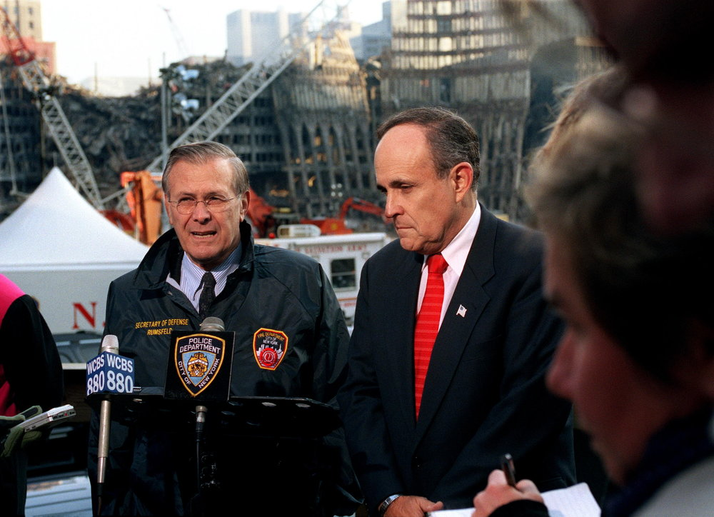 Finest hour: Then New York City Mayor Rudolph Giuliani with then Secretary of Defense Donald Rumsfeld at the remains of the World Trade Center site, Nov. 14, 2001. Photograph by Robert D. Ward.