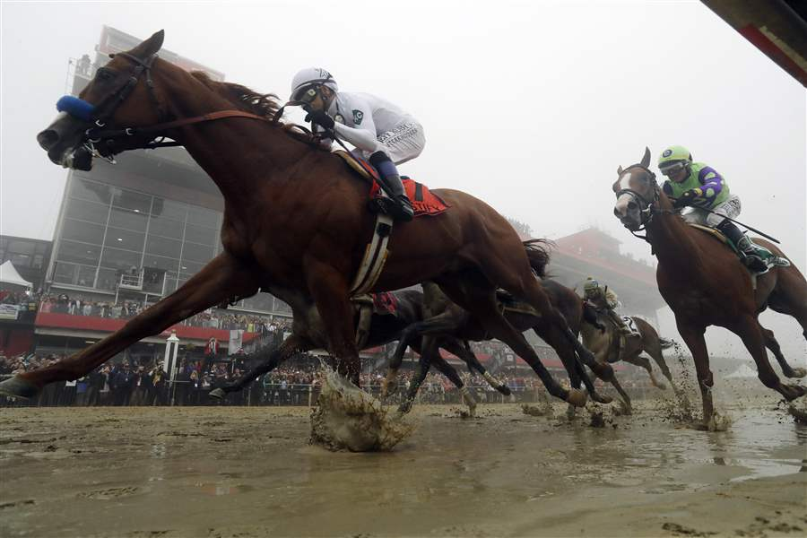 Justify with Mike Smith atop wins the the 143rd Preakness Stakes horse race at Pimlico race course in Baltimore. Photo  here  from AP.