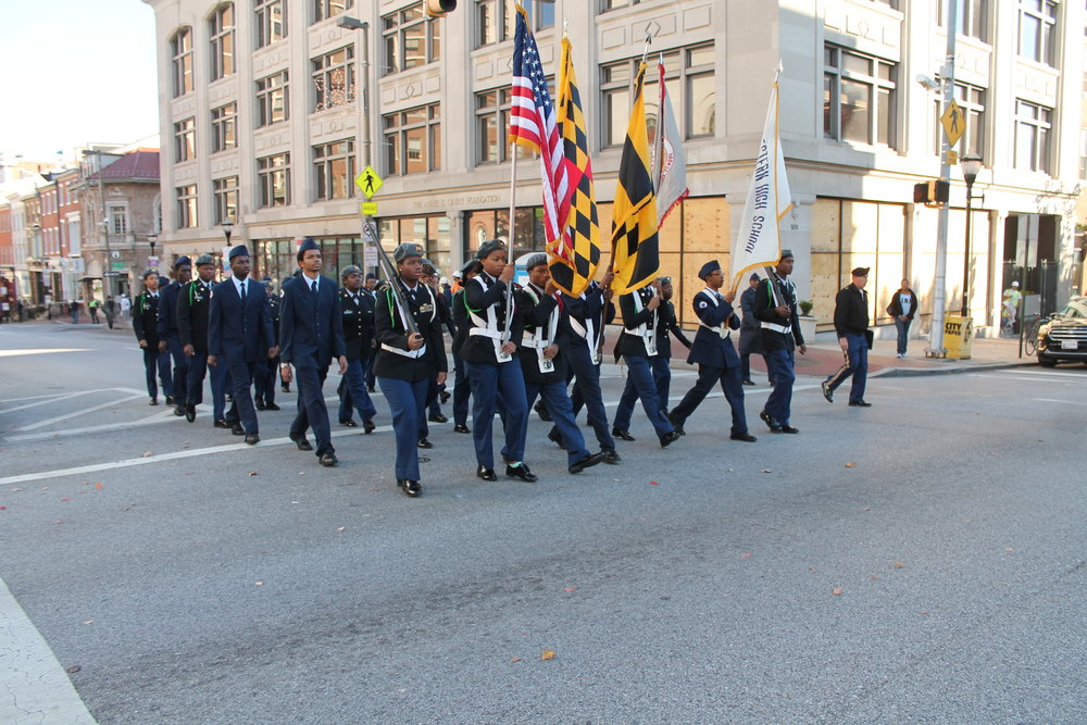 Caption: A typically low-key Veterans Day Parade in the U.S. of A., this one in Baltimore in 2016. Photograph by Elvert Barnes.
