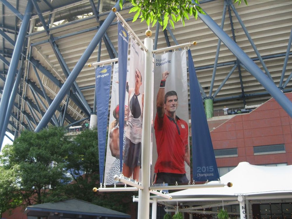 Banner for Novak Djokovic at the USTA Billie Jean King National Tennis Center proclaiming his 2015 US Open championship. This year's winner, Djokovic found himself caught up in the Serena Williams-Carlos Ramos controversy at the Open, like everyone else. Photograph by the author.