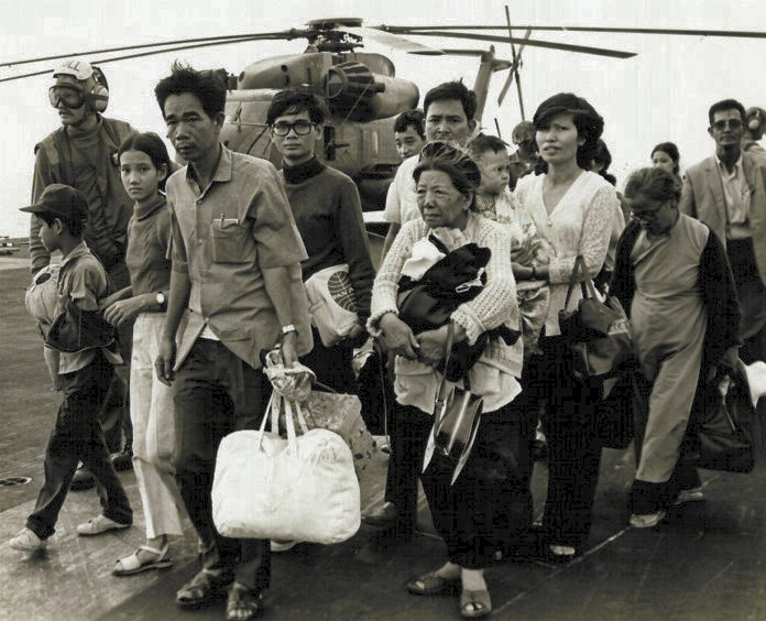 South Vietnamese refugees arrive aboard a U.S. naval vessel during the fall of Saigon, April 29, 1975.