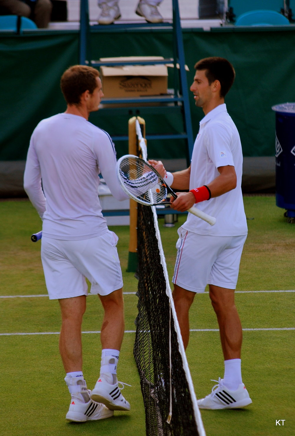 Andy Murray and Novak Djokovic at The Boodles Tennis Challenge exhibition in Stoke Park, Buckinghamshire, England in 2012.