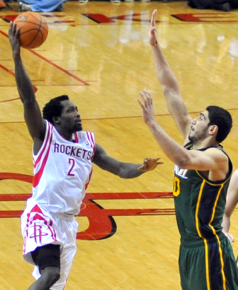 Enes Kanter (right), — then of the Utah Jazz, now of the New York Knicks — attempting to block a shot by Patrick Beverley at the Houston Rockets' Toyota Center March 17, 2014.
