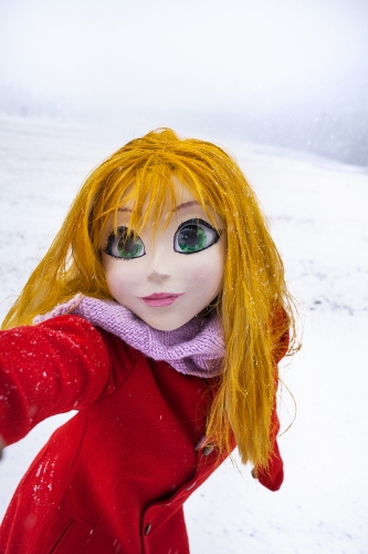 Yellow Hair/Red Coat/Snow/Selfi by Laurie Simmons, 2014