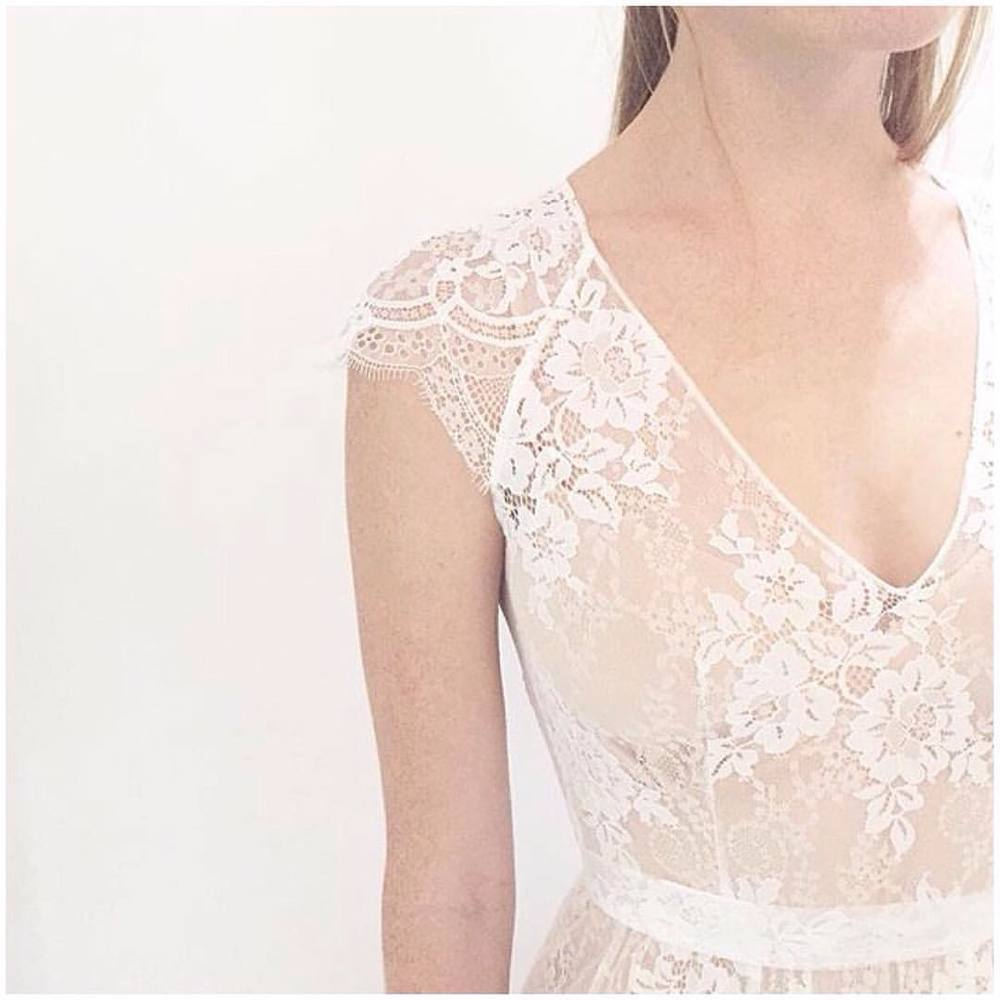 """Simplicity at its best…. """"Sabine"""" Gown… Lovely detail shot…fell in love with this unique lace edging… And open scallop back on this is just right 💕💕💕 #bridalmarket #tatyanamerenyuk #tatyanamerenyukbridal #whimsy #fashion #style #stylish #cute #tatyanamerenyukbridal #hair #beauty #beautiful #pretty #design #bridaldress #dress #wedding #weddingdress #bohochick #boho #whitedress #weddinginsporation #lace #о#bride #nycdesigner #brooklyndesigner #bridal #brooklynbride"""