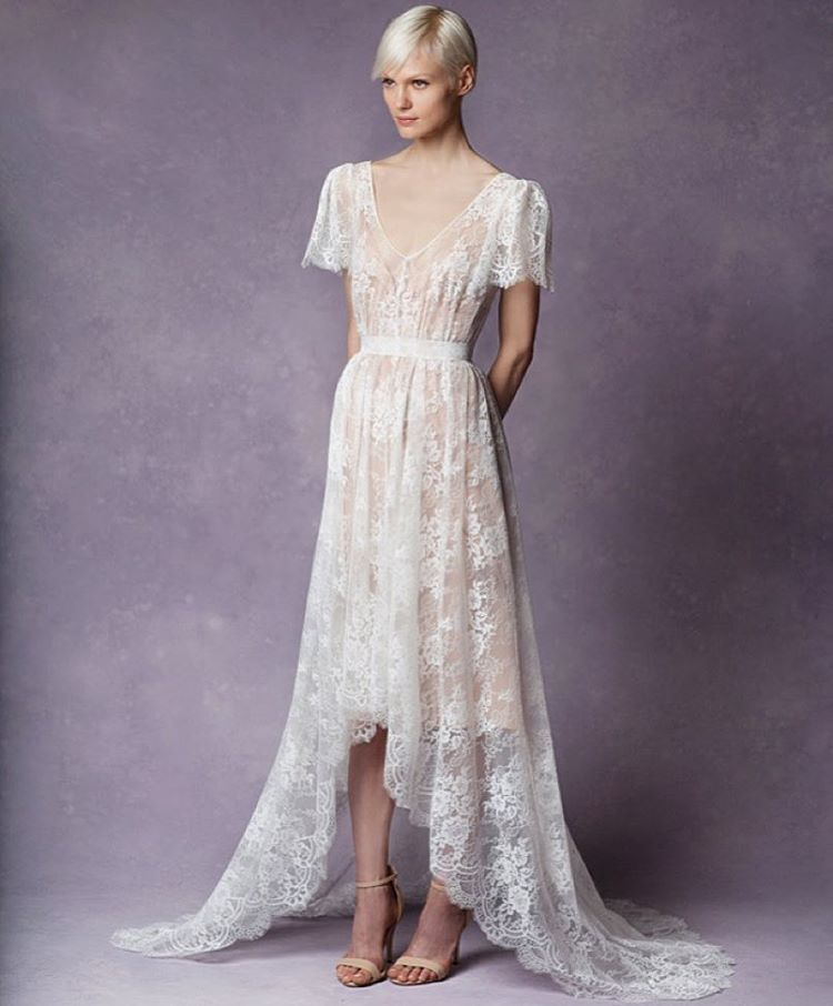 "Meet the lovely ""Eden"" Lace Dress look #3 with gorgeous high low drape and v-neck and love the flutter sleeve and buttery silk slip 😍😍😍….#bridalmarket #tatyanamerenyukbridal #whimsy #fashion #style #stylish #cute #tatyanamerenyukbridal #hair #beauty #beautiful #pretty #design #bridaldress #dress #wedding #weddingdress #bohochick #boho #whitedress #weddinginsporation #lace #о#bride #nycdesigner #brooklyndesigner #bridal #brooklynbride"