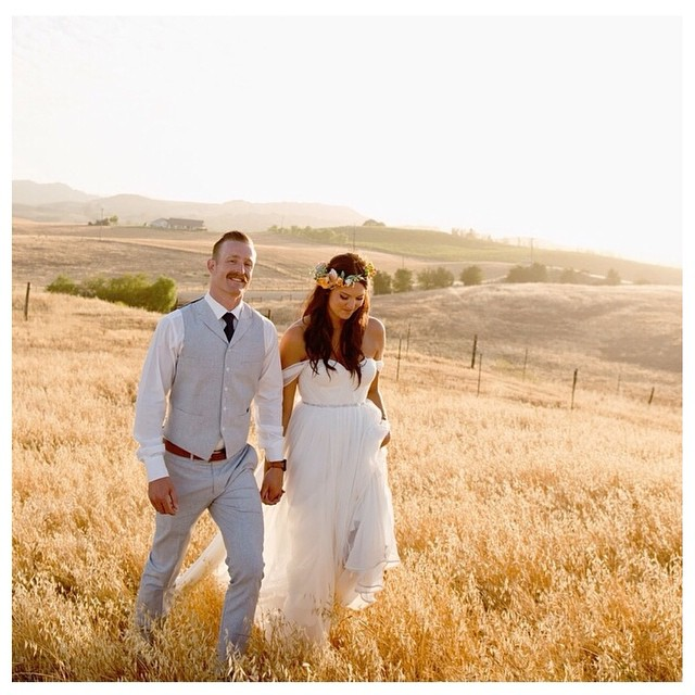 This gorgeous California couple! 💕 Nicole is wearing her custom #tatyanamerenyuk #gown. #tatyanamerenyukbridal #bohobride #boho #bohemian #bohochick #bohemianwedding #wedding #weddingdress #weddinginspiration #bride #fashion #dress #whitedress #nycdesigner #custom #california #bride #pretty
