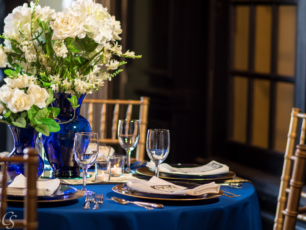 gold and navy table setting