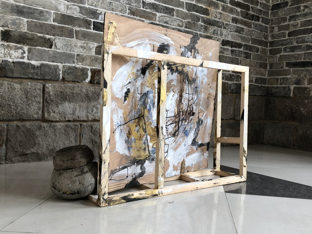 Improvisation No.2  36x35x10in, Reclaimed wood crate, found wood panel, found stone, acrylic, ink, oil bar, found packaging, found plastic cup, found music sheet, 2018