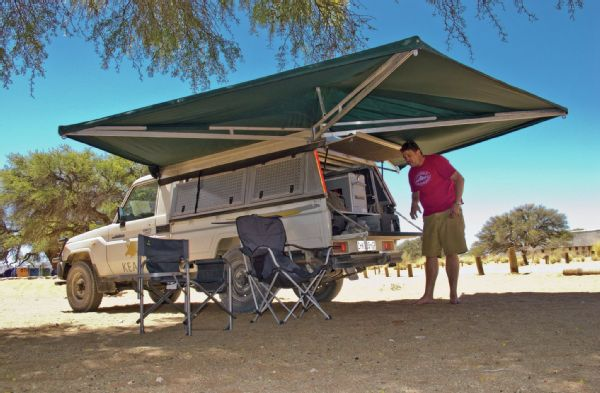 An Ostrich Wing Awning is a must for shade, it also provides shelter from the rain as well.