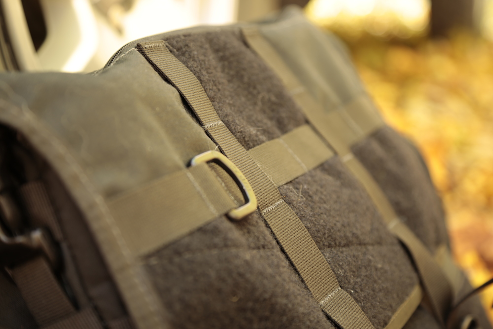 The front flap with stitched hook and loop panels for accommodating  VELCRO pouches .