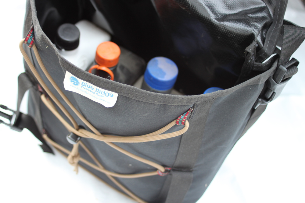 The Overland Oil Bag pictured with some fluids I like to keep handy on each trip.