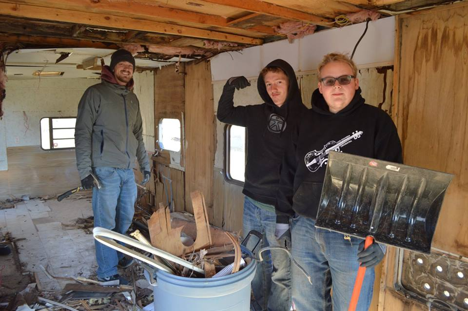 Some of the guys clearing out a trailer that will be used for storage for upcoming ministry supplies!