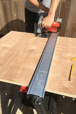Brian cutting table top with Bora Edge Saw Guide.
