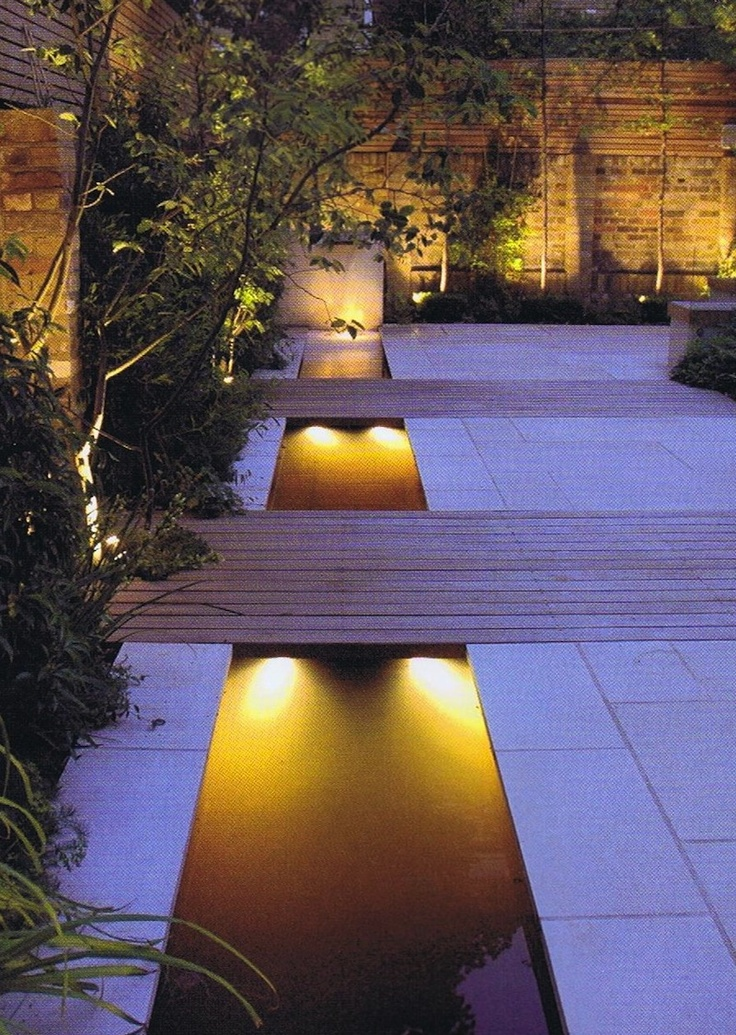 Lovely use of lighting to highlight stepping of the water feature