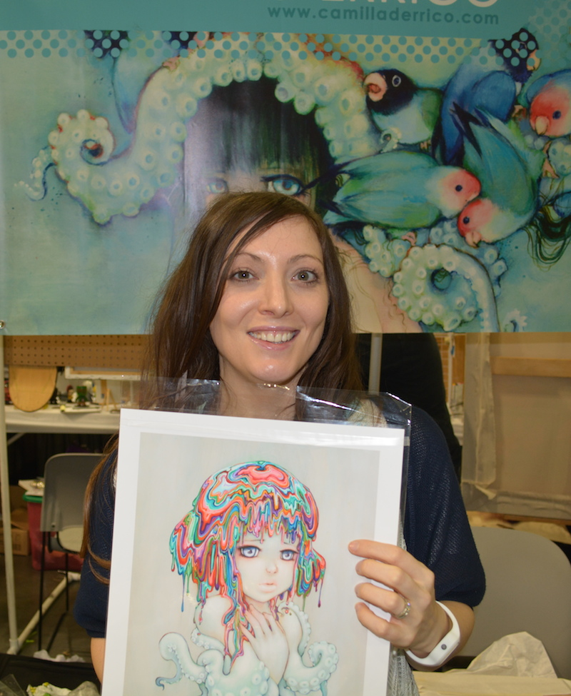 Camilla D'Errico with the print she signed for WoTR.