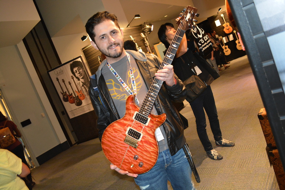 Frank holding one of the limited edition Santana guitars @ PRS. NAMM 2015. ©WoTR Radio