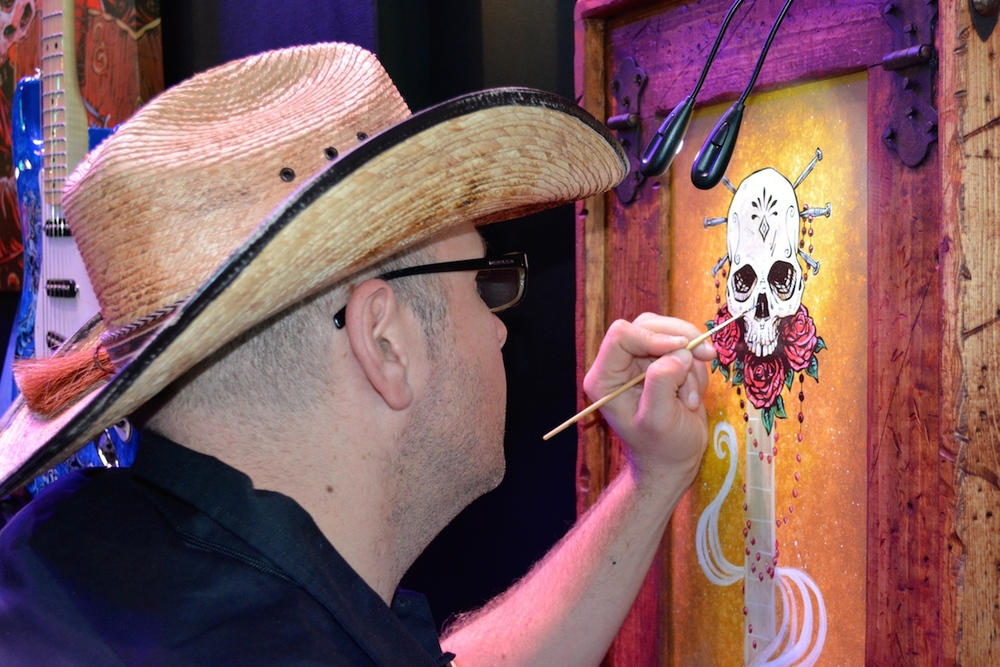 """Lil' Devils Want To Rock"" artist, live painting in the Fender room. NAMM 2015. ©WoTR Radio"