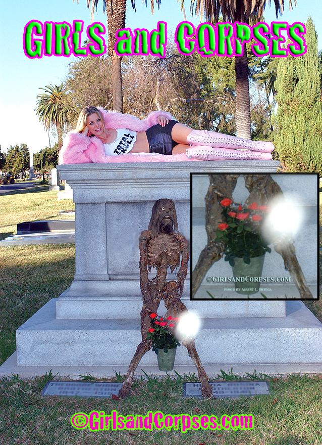 Sheri Moon Zombie, posing alongside Rob Zombie's corpse – note the strange white orb by the flowers.  Photo courtesy of Girls and Corpses.