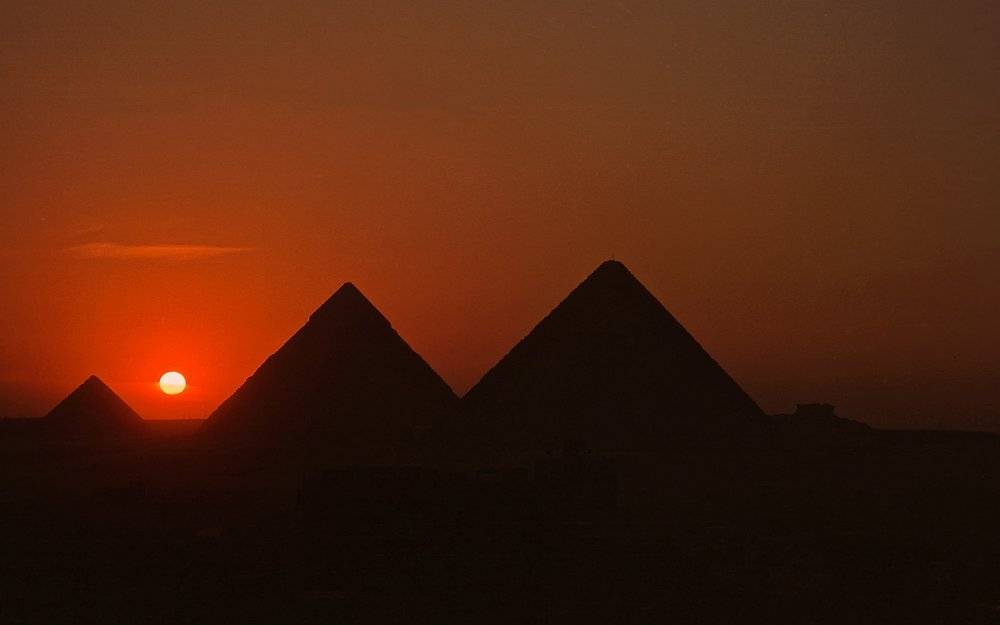 The Pyramids of Giza at dusk - Giza, Egypt.