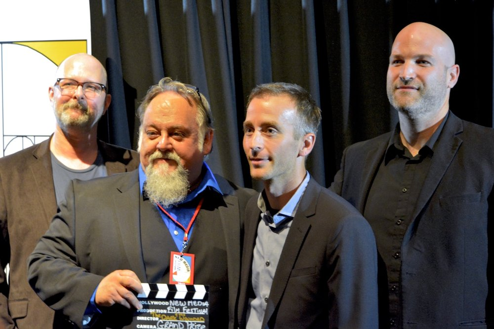 "James Picard and The Dark and The Wounded production team, accepting the Grand Prize Award for ""Best Film"" at the New Media Film Festival in Los Angeles."