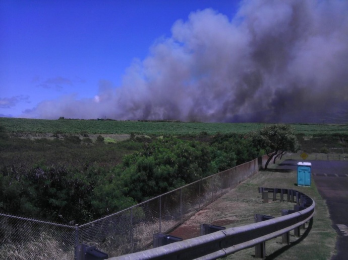 "Above: ""Pāʻia unscheduled cane burn."" Credit: Karen Chun"