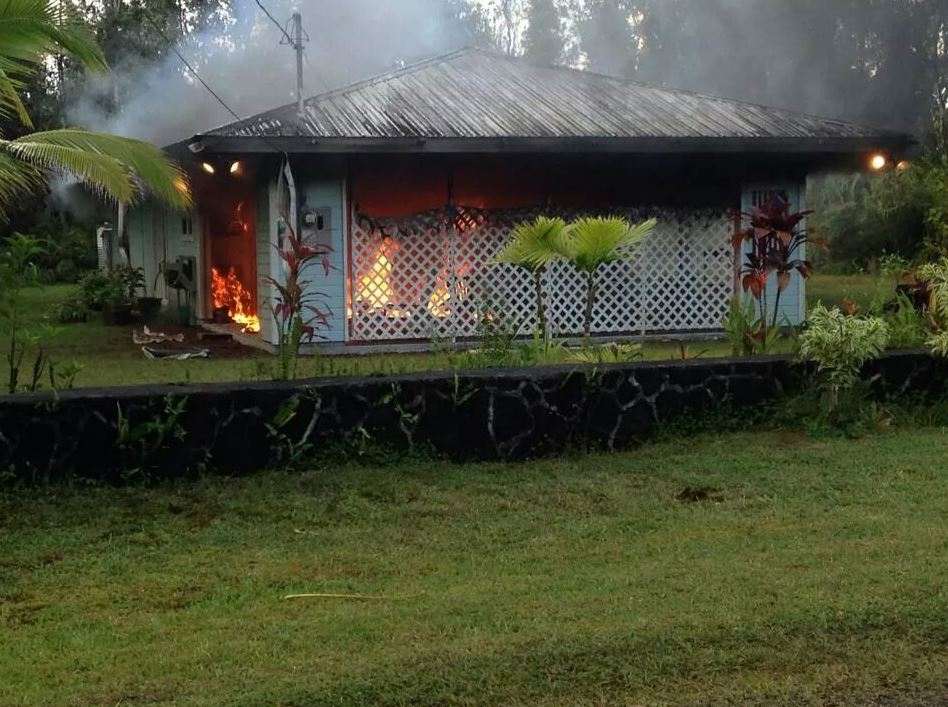 "Above: ""Fire engulfs home in Nanawale Estates."" Credit - Hawaii News Now"