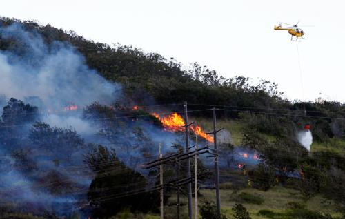 "Above: ""Honolulu firefighters battled a brush fire Friday above Umena Street in Makakilo.""Credit - Krystle Marcellus/Star Advertiser"