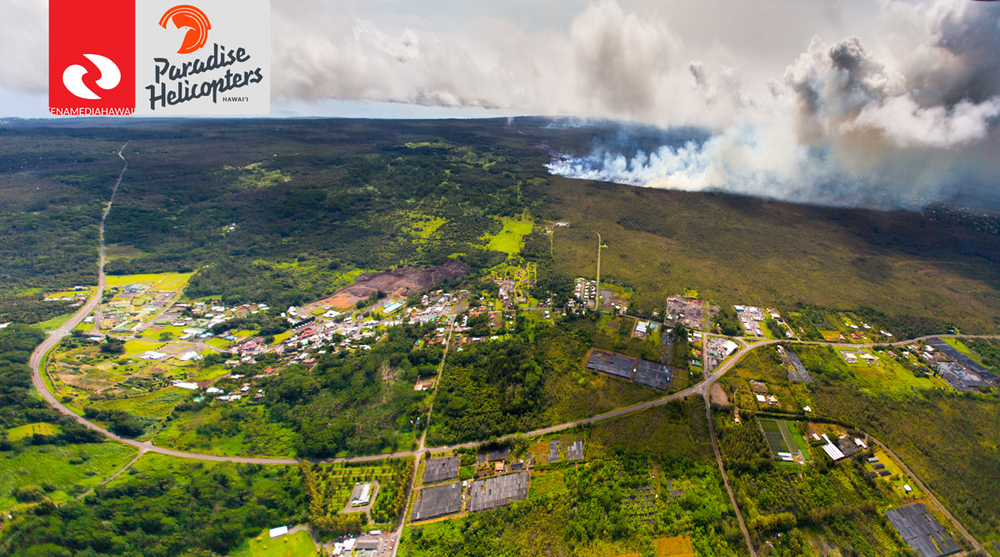 "Above: ""Photo of lava flow and brushfire taken Oct. 6 by Ena Media Hawaii / Paradise Helicopter. Residents of Ainaloa, Orchidland, Kea'au, even all the way up to Hilo, could smell the smoke, and in some cases, could feel the ash, for much of the day."" Credit - Paradise Helicopters"