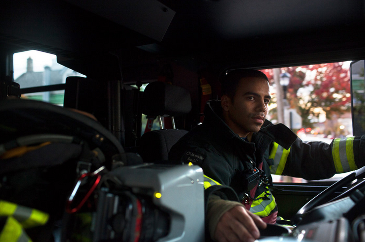 "Above: ""Probationary firefighter and military veteran Victor Ramos gets truck driving practice near the 16th Street Firehouse in Union City, N.J. New Jersey's North Hudson Fire Department hired 43 veterans this year."" Photo Courtesy of Melanie Burford, NPR"