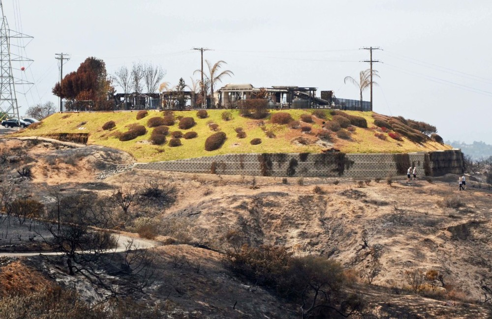 "Above: ""The New Message. The photo above shows two homes with extensive defensible space and proper vegetation management that burned during the May 14, 2014, Poinsettia Fire in Carlsbad, California. Addressing the entire fire risk reduction equation is essential."""