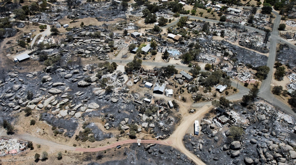 "Above: ""This aerial photo shows Yarnell, Ariz., days after a fire claimed the lives of 19 members of an elite firefighting crew."" Credit: Tom Tingle / AP"