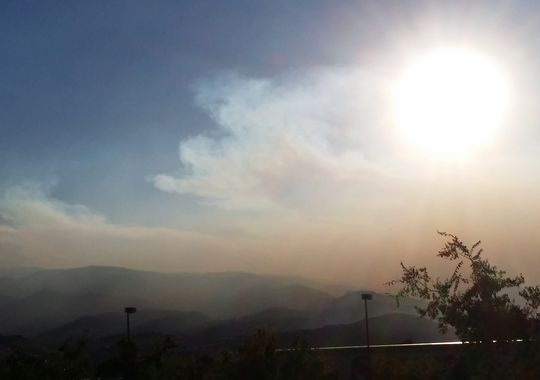 "Above: ""Setting sun viewed through smoke as it is starting to blow into Reno from the west on Wednesday evening. The smoke is from the King Fire in California on Wednesday, Sept. 17, 2014."" Credit - Terry Dee"