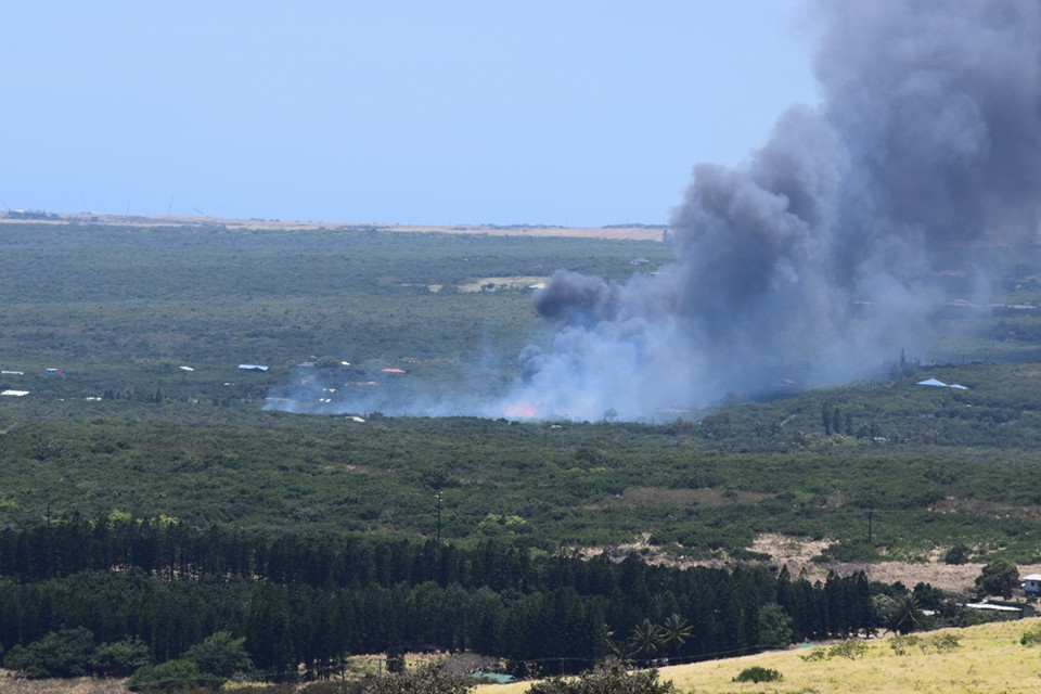 """Naalehu brush fire. Photo credit: Eric Fandrick."""