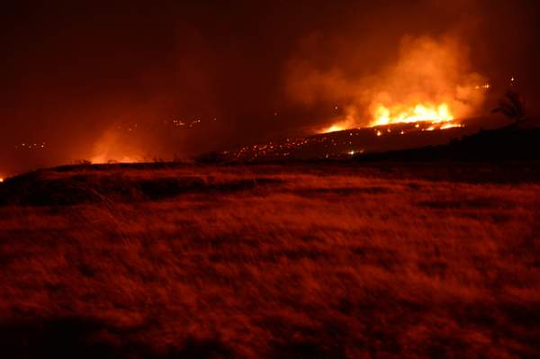 """ The brush fire burns Saturday night near Kawaihae. Maisie Grossart/Special to West Hawaii Today"""