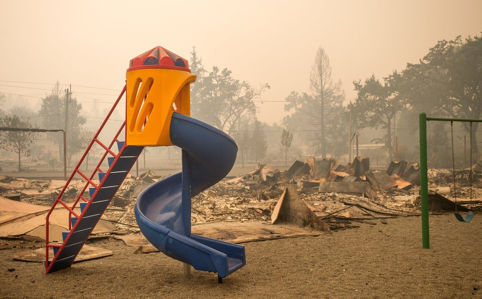 """A playground is surrounded by smoldering rubble in Middletown, California, Sept. 13, 2015."" Credit: Josh Edelson/Getty Images"